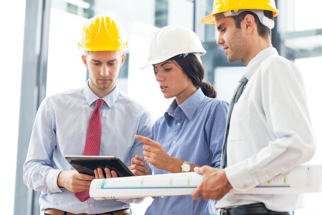 Engineers using digital tablet